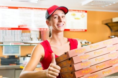 Delivery service - woman holding pizza boxes
