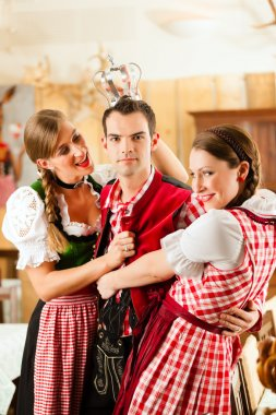 people in traditional Bavarian Tracht in restaurant or pub