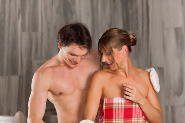 Wellness - couple getting a massage and cleansing