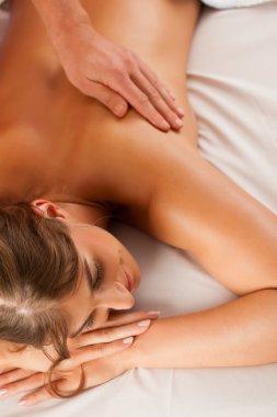 Woman enjoying wellness back massage