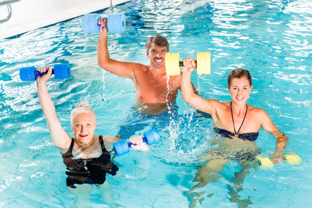 Group of people at water gymnastics or aquarobics