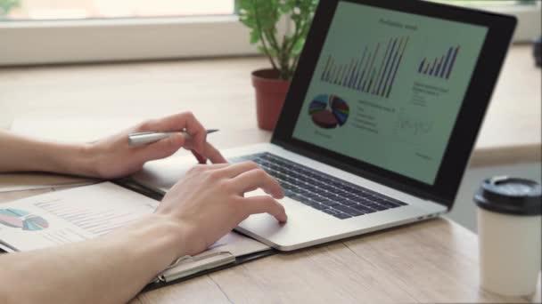 business man using a laptop to analyze marketing data.