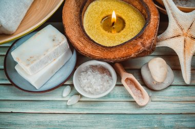Spa setting with coconut oil,