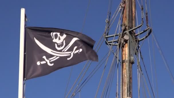 Sunlit pirate flag waving in the wind