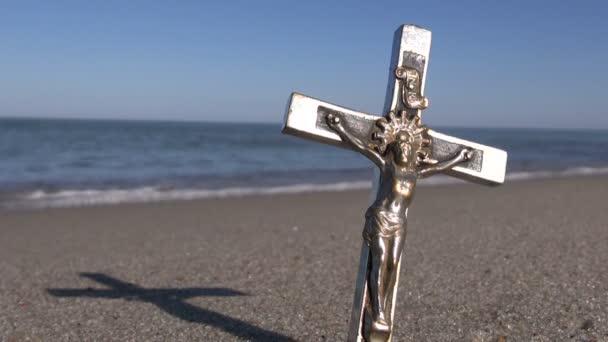 Crucified Jesus Christ on a metal cross on  beach