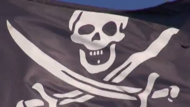 Black pirate flag waving on  windy day