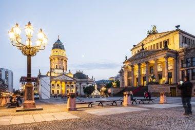 Berlin - Germany  - September 30.  Tourists walk on Gendarmenmarkt in Berlin. French cathedral (Franzosischer Dom) and Concert Hall (Konzerthaus).