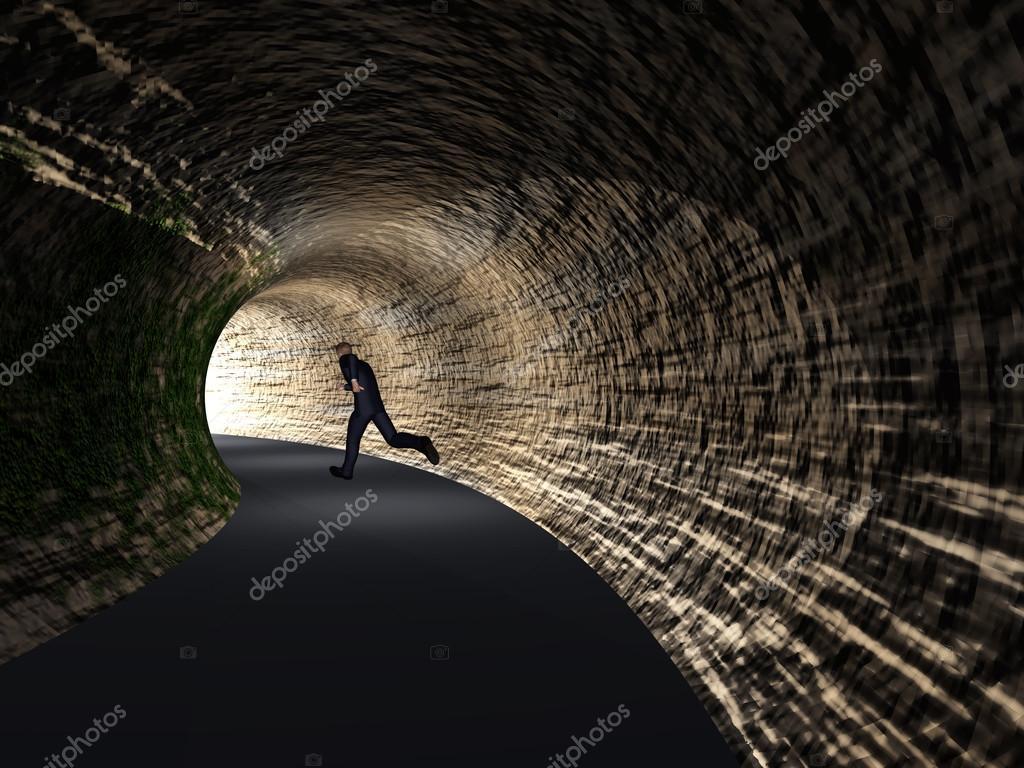 Business Man Running In Dark Road Tunnel Stock Photo