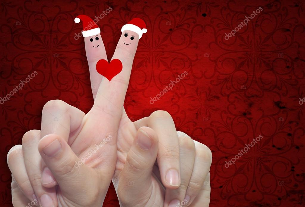 fingers in love with Christmas hats — Stock Photo © design36 #76345949