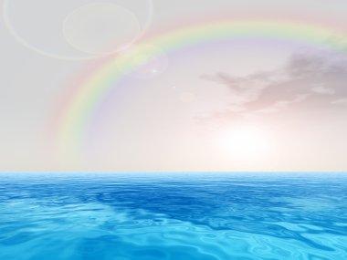 ocean and sky with rainbow