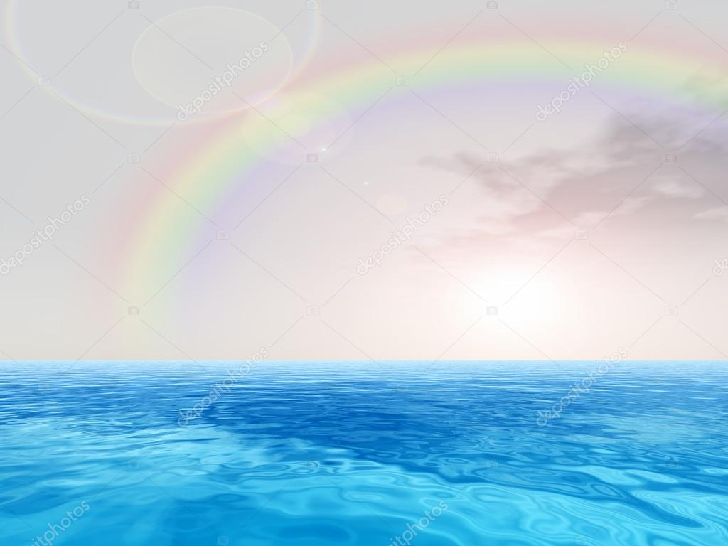 ocean and sky with rainbow