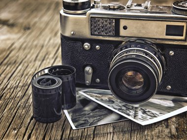 Old vintage camera closeup on wooden background stock vector