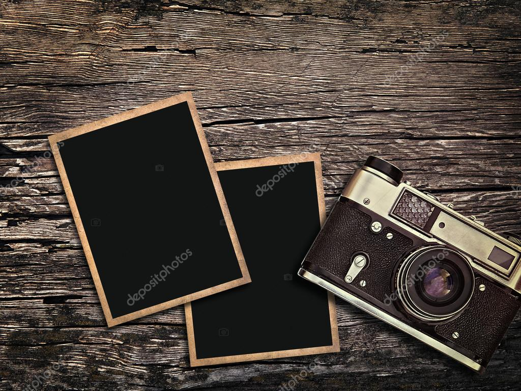 Old Vintage Camera And Photos On A Wooden Background Stock