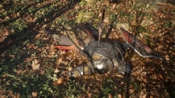 On the battlefield, in the midst of autumn leaves, lies a wounded medieval knight. The animation is for historical, medieval or military backgrounds.