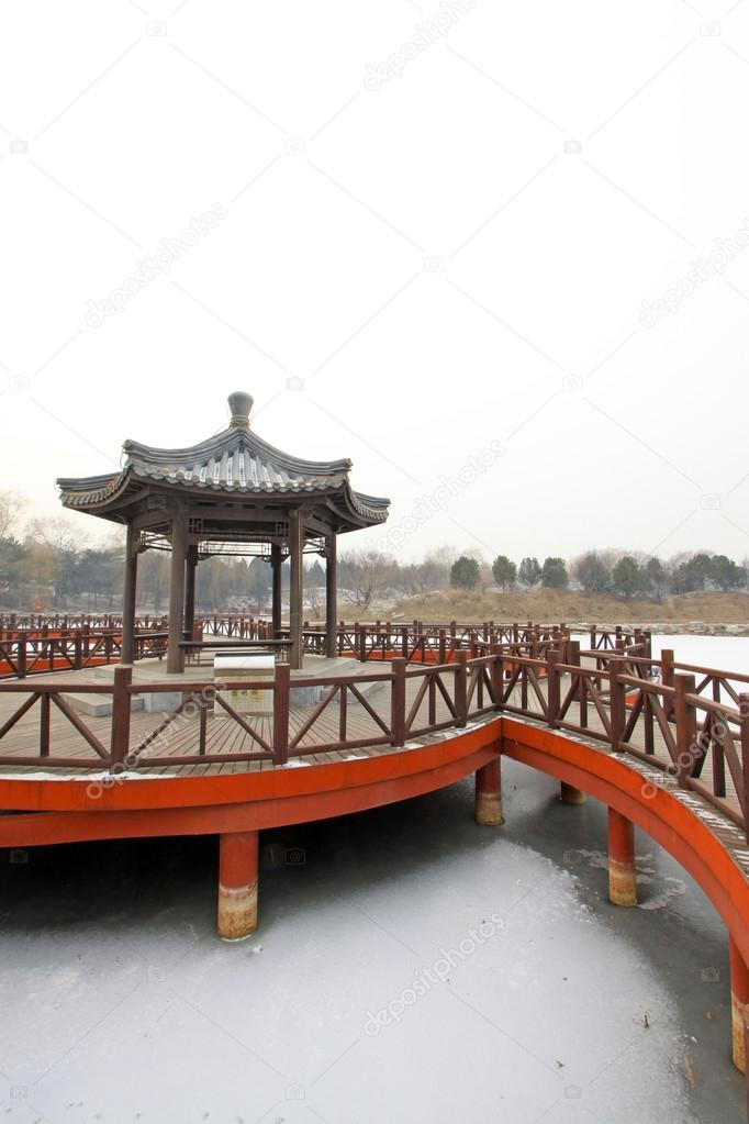 chinese pavilion on lake in park
