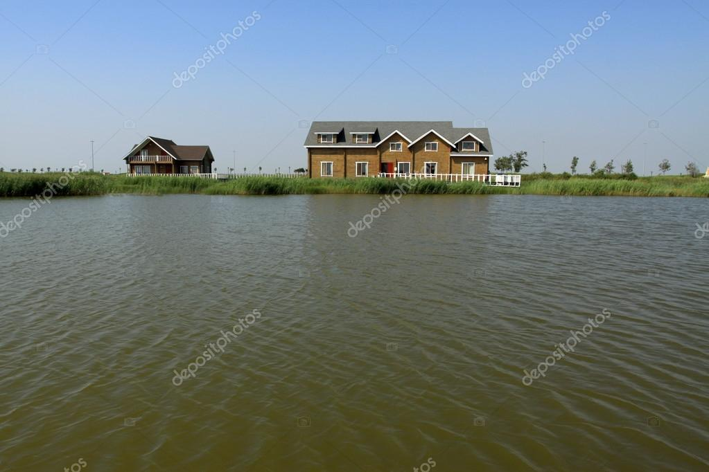 cottage houses by river