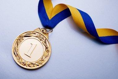 Gold medal on blue