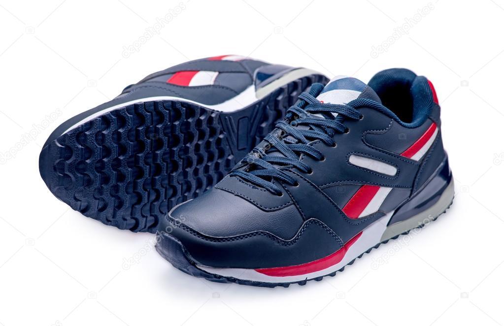 e96b7aa517c Ένα ζευγάρι των μπλε αθλητικά παπούτσια με κορδόνια σε λευκό φόντο — Εικόνα  από ...
