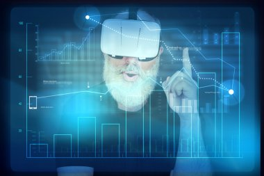Aged man in virtual reality headset in front of interactive scre