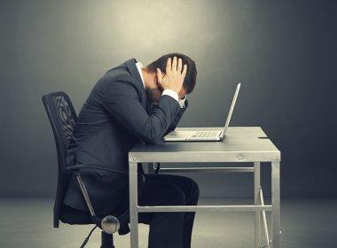 depressed businessman sitting