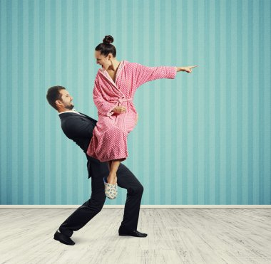 man holding angry young wife
