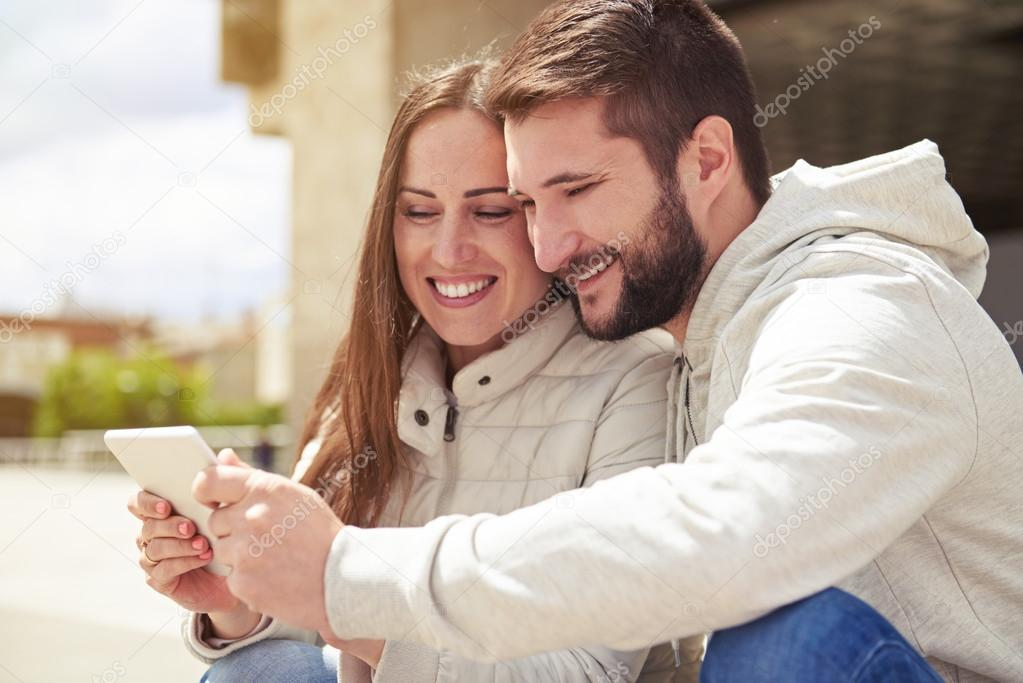 couple in love looking at tablet pc