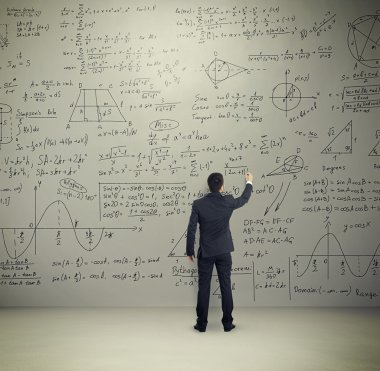 man in formal wear writing formulas