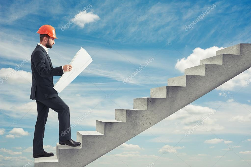 Man holding blueprint stock photo konstantynov 77064469 businessman in orange hardhat holding blueprint and following up on concrete stairs over blue sky photo by konstantynov malvernweather Choice Image