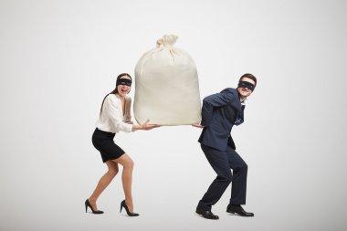 man and woman holding big bag
