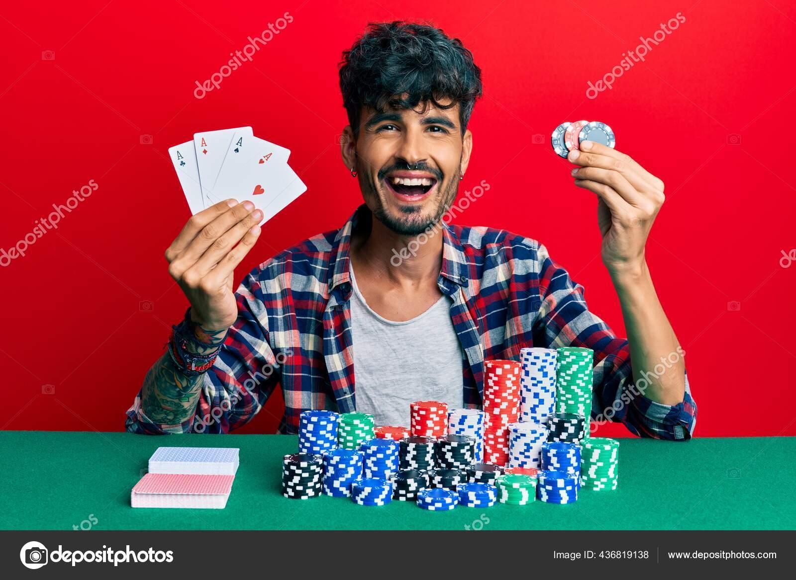 Pemuda Hispanik Bermain Poker Memegang Kartu Dan Chip Kasino Tersenyum Stok Foto C Krakenimages Com 436819138