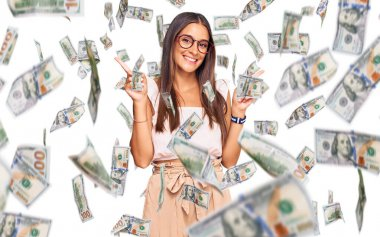 Young hispanic woman wearing casual clothes and glasses smiling confident pointing with fingers to different directions. copy space for advertisement