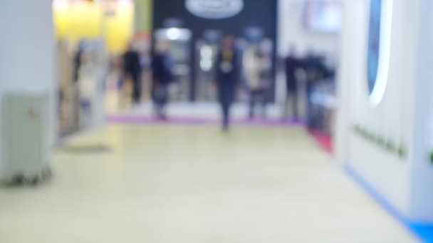 Business theme background. Unrecognizable people in a large and bright business center. Blurry defocused video