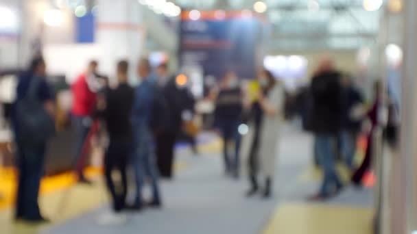 business and finance. background. unrecognizable people in the lobby of the modern business center. blurry defocused video