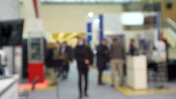 Blurred business background. Silhouettes of unrecognizable people inside a large mall