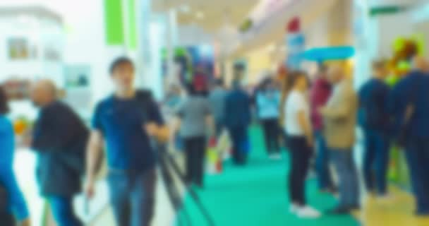business and finance background. unrecognizable people in the lobby of the business center. blurry defocused video