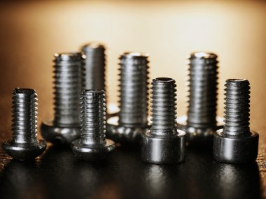 Nuts and bolts on a black background