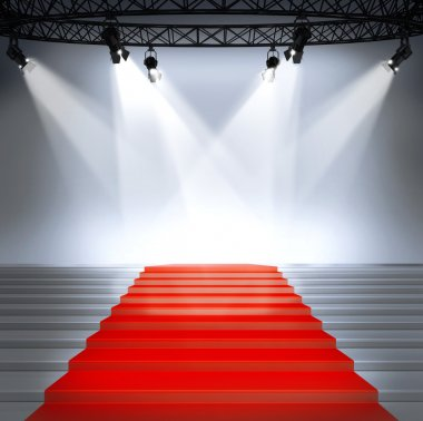 Illuminated empty stage podium with red carpet for award ceremony