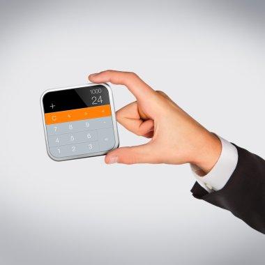 Man hand holding object. Calculator.