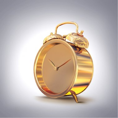 Golden old fashioned  alarm clock on grey  background.