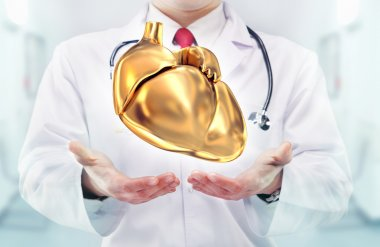 Doctor with stethoscope and golden heart on the  hands in a hospital. High resolution. stock vector