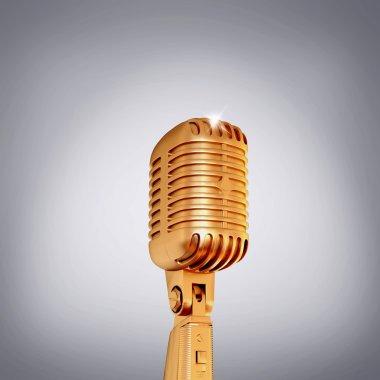 Golden retro microphone on grey background.
