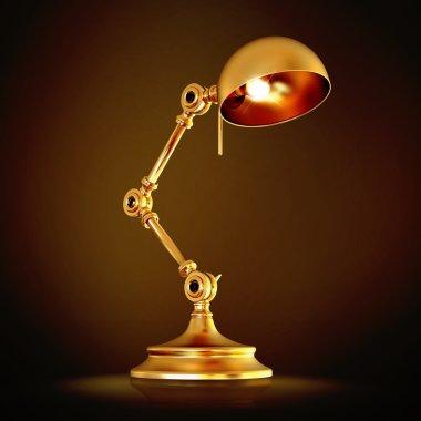 Vintage golden lamp on black background