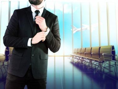 Businessman on blurred background airport.