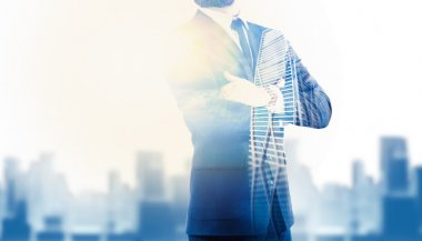 Double exposure of city and business man