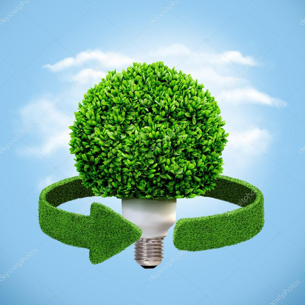 Conceptual eco energy. Lamp and green arrows from the grass. Recycling concept
