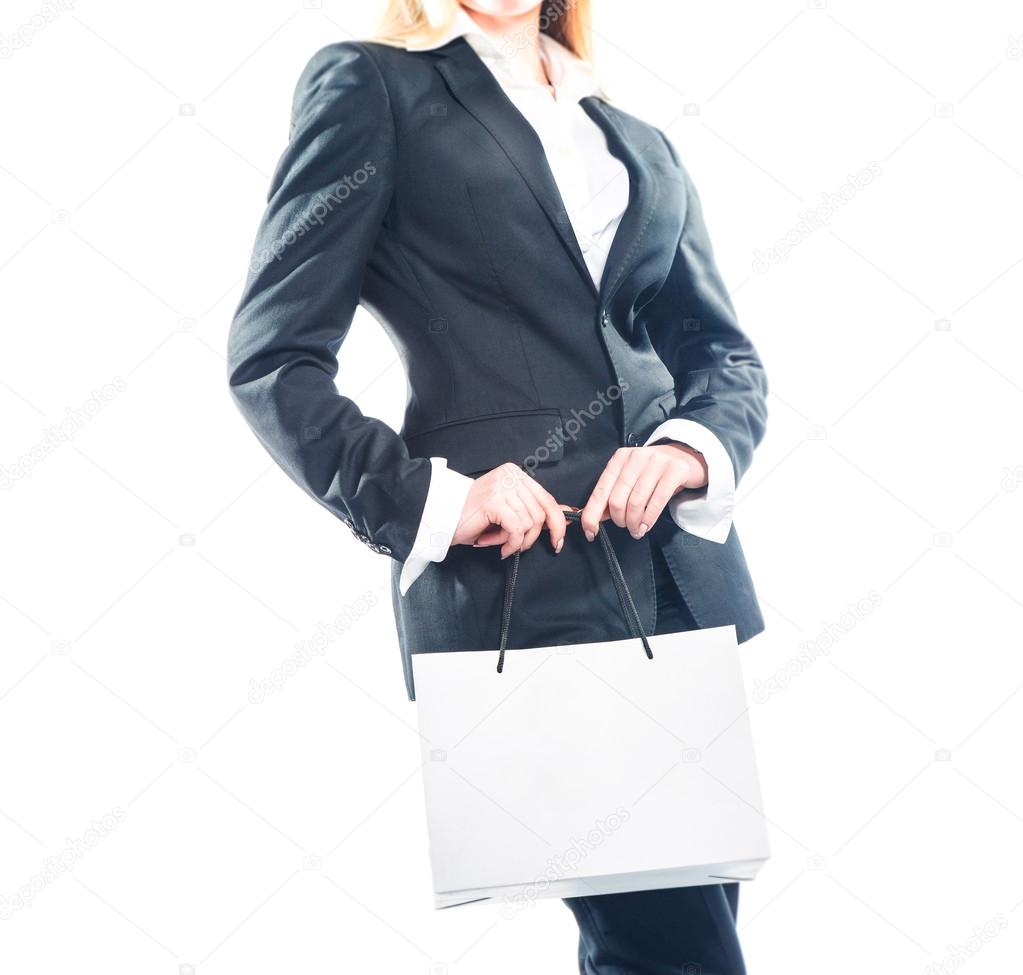 Business woman standing with paper bag isolated on white