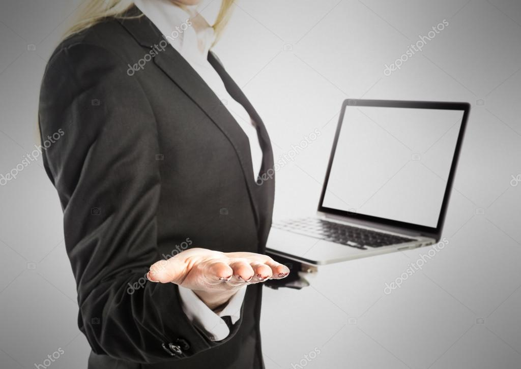 Business woman with laptop on gray background