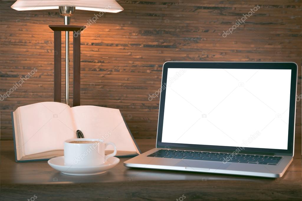 Open book, laptop and cup with coffee over wooden table, retro filtered image