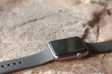 Smart watch on stone background. Mockup