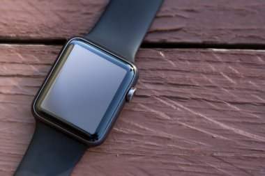 Smart watch on wood background. Mockup